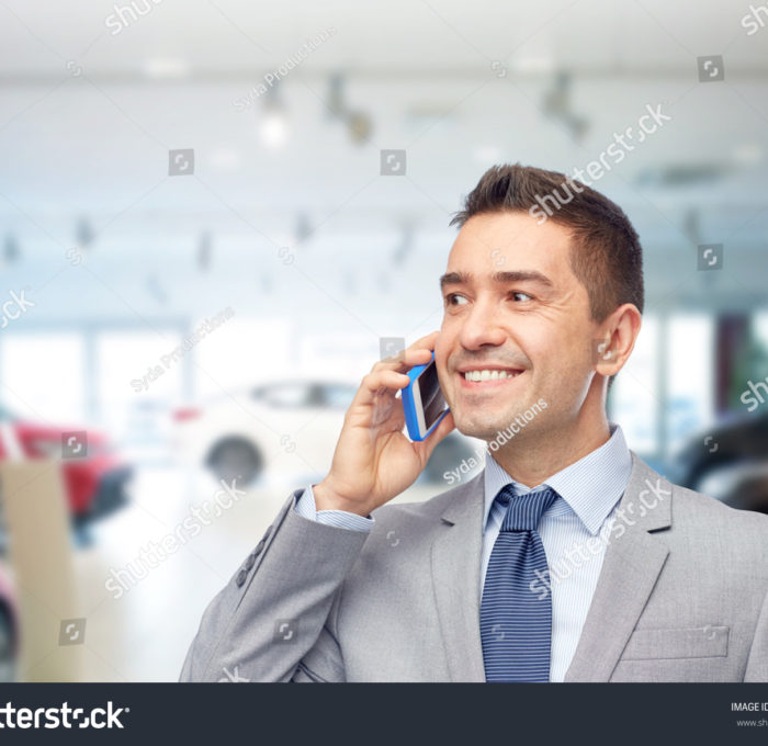 stock-photo-business-car-sale-people-and-technology-concept-happy-businessman-calling-on-smartphone-over-256174852